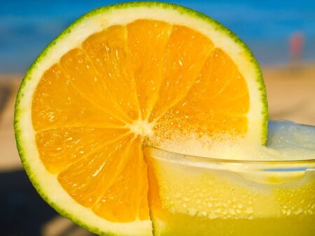 Orange cocktail on the beach photo