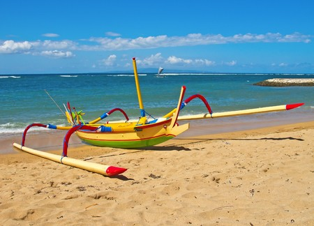 Traditional balinese dragonfly boaton the beach photo