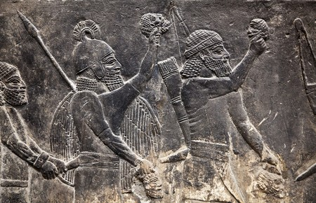 Ancient Assyrian wall carvings (warriors with weapon)
