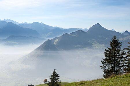 Misty autumn morning in swiss alps photo