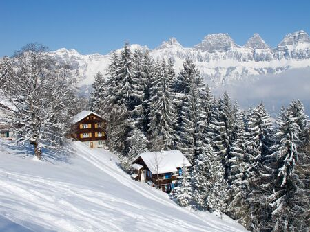 Winter holiday house in swiss alps photo