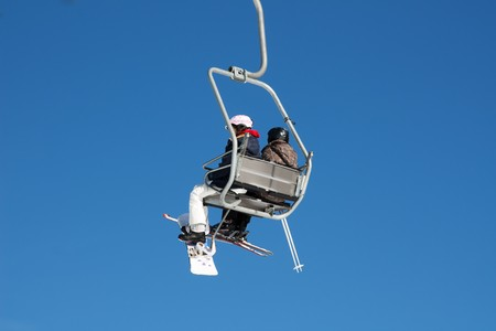 Skiers on the ski lift (Amden, Switzerland) photo