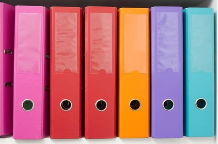 Colorful office folders on the bookshelf Stock Photo - 7765229