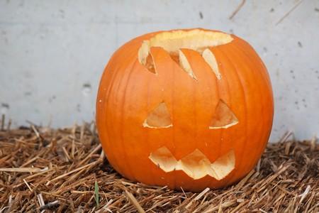 hollows: Halloween pumpkin against the wall Stock Photo