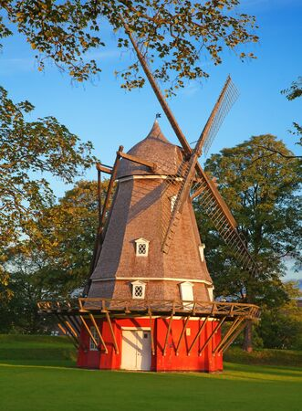 Old red windmill in the Copenhagen, Denmark photo