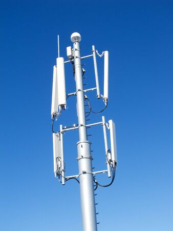 telco: GSM Antenna against blue sky Stock Photo