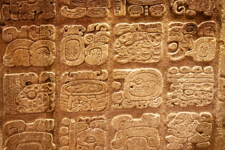 past civilizations: Mayan hieroglyphs carved on the lime stone