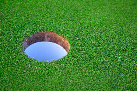 Golf hole on the green grass photo