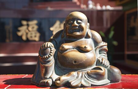 chinese buddha: Lucky buddha statue in chinese temple