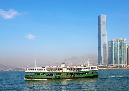 Ferry boat in Victoria Harbor, Hong Kong photo
