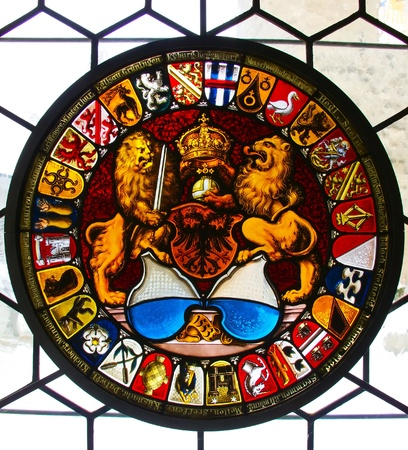 Stained glass window in ancient Kyburg castle near Zurich photo