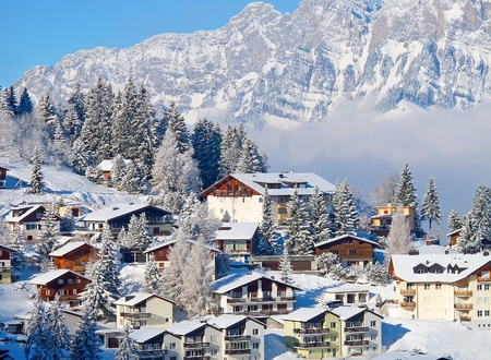 the swiss alps: Winter holiday houses in swiss alps Stock Photo