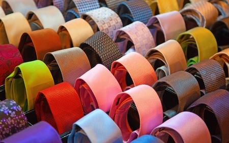 Shelf full of fine silk neckties on a Chinese street market photo