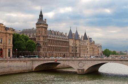 Castle Conciergerie and bridge of Change, Paris, France photo