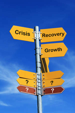 Crisis or recovery? direction sign photo