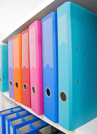 Colorful office folders on the bookshelf Stock Photo - 8780309