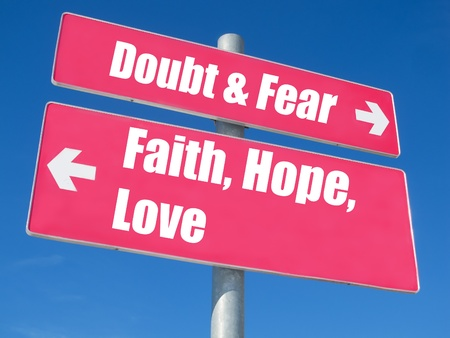 active arrow: Faith, Hope, Love vs. Doubt & Fear signpost against blue sky