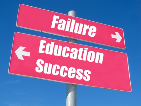 Education, Success vs. Failure signpost against blue sky photo