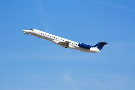 Private Corporate Business Jet taking-off to the blue sky photo