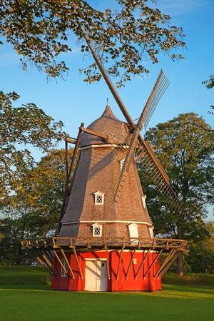 Old red windmill in the Copenhagen, Denmark photo