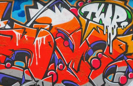 Fragment of the colorful graffiti on the wall photo