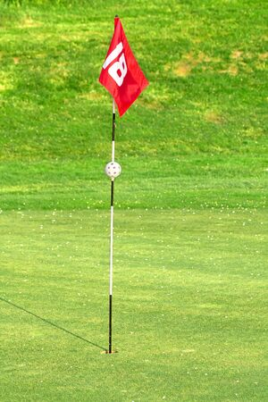 putt: 18th flag on the golf course Stock Photo
