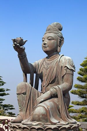 Bodhisattva statue located in Po Lin Monastery, Lantau Island, Hong Kong, China photo