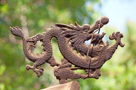 Bronze dragon on the incense pot in Po Lin monastery on Lantau Island (Hong Kong) photo