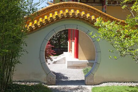 Traditional chinese garden. entrance with round gate photo