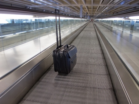 Business suitcase in the empty airport photo