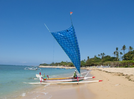 Traditional balinese boat on the beach photo