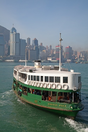 HONG KONG - DECEMBER 3: Ferry Meridian star leaving Kowloon pier on December 3, 2010 in Hong Kong, China. Ferry is in operation for more than 120 years and it is one main tourist attractions of the city.