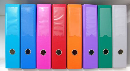 Colorful office folders on the bookshelf Stock Photo - 10024628