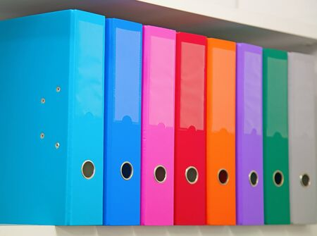 Colorful office folders on the bookshelf Stock Photo - 10023917