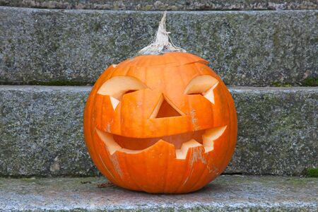 Jack-o-lantern pumpkin near the house photo