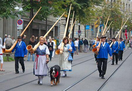 alphorn: ZURICH - AUGUST 1: Swiss National Day parade on August 1, 2009 in Zurich, Switzerland. Musicians marching with traditional swiss alphorns Editorial