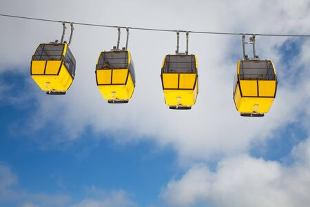 Row of cable cars in the sky photo