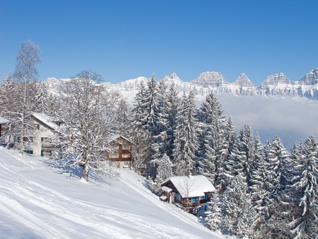 Winter holiday house in swiss alps Stock Photo - 10282229