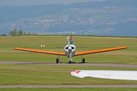 cessna: Small ariplane on the ground near hangar