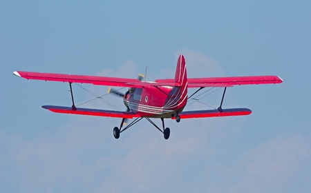 Small biplane in the sky Stock Photo