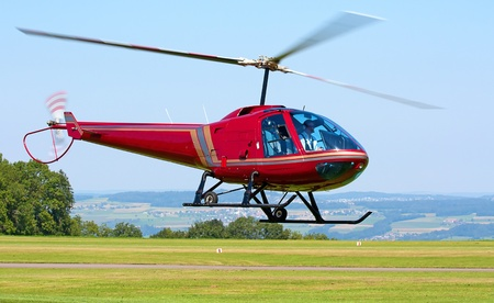 Helipcopter taking off from the small airfield photo