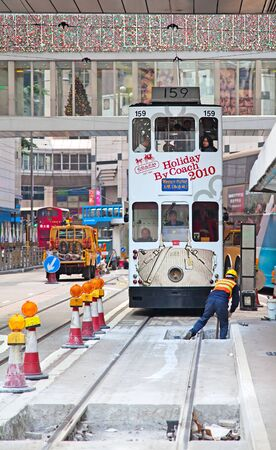 HONG KONG - DECEMBER 05: Repair work on city tram line in Hong Kong on December 05, 2010. Tram in Hong Kong is the only tram system in the world run with double deckers and one of the main tourist attractions. Stock Photo - 10466442