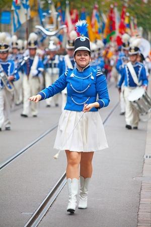 helvetica: ZURICH - AUGUST 1: Swiss National Day parade on August 1, 2009 in Zurich, Switzerland. Parade opening with Zurich city orchestra