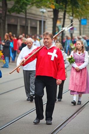 helvetica: ZURICH - AUGUST 1: Swiss National Day parade on August 1, 2009 in Zurich, Switzerland. Representative of canton Schwyz in the national costumes. Editorial