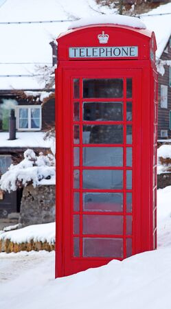 Famous Londons red telephone booth in snow photo
