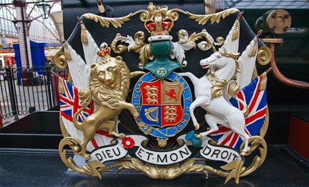 Lion and unicorn on English heraldic coat of arms on an ancient steam train in Windsor