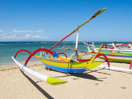 Traditional balinese dragonfly boat on the beach