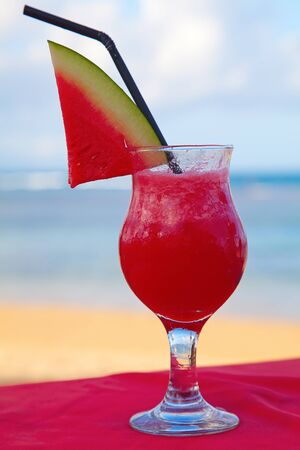 Water melone cocktail on the beach photo
