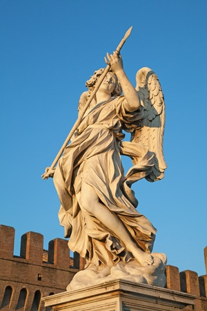 Berninis marble statue of angel with spear from the SantAngelo Bridge in Rome, Italy photo