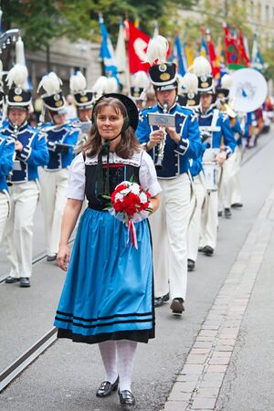 the national team: ZURICH - AUGUST 1: Swiss National Day parade on August 1, 2009 in Zurich, Switzerland. Woman in a historical costume.